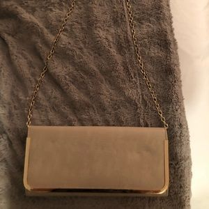 Also tan/nude clutch/ going out bag